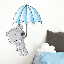 Teddy bear with umbrella