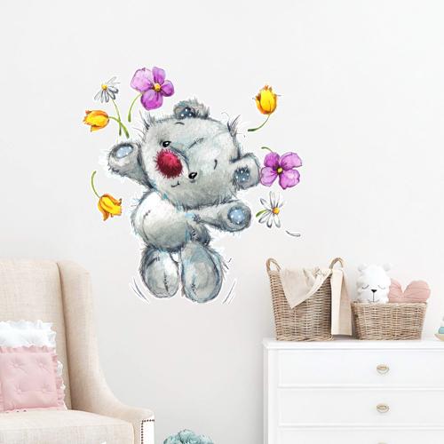 Happy teddy with flowers